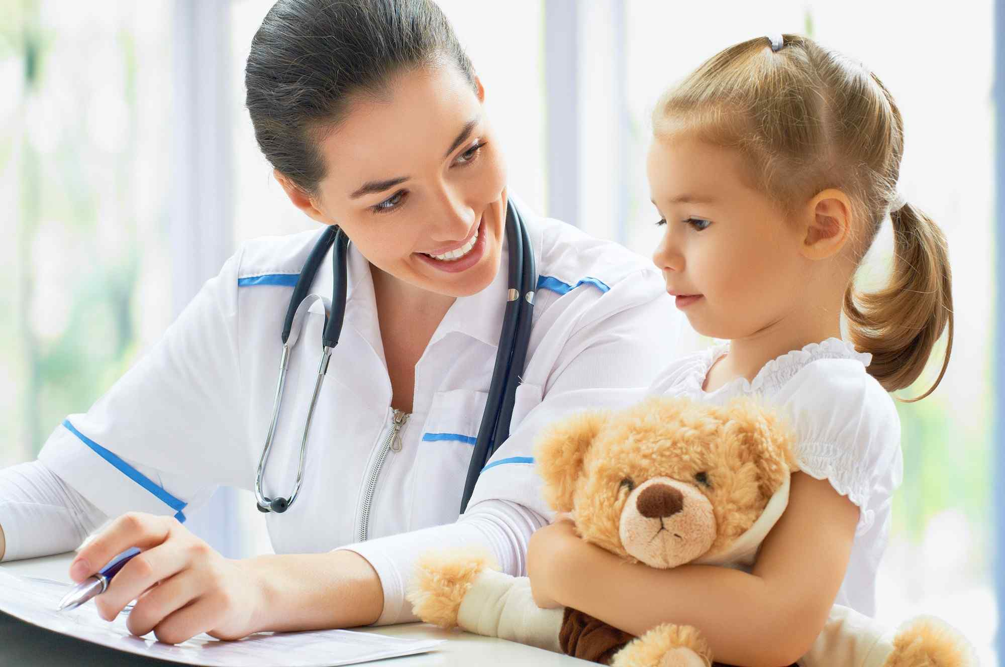 a doctor assessing the adhd and add needs of a child at kid care pediatrics