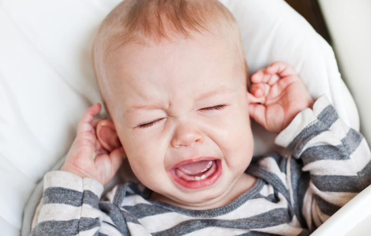 Teething can cause symptoms like whining and fussiness.